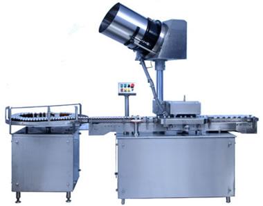 AUTOMATIC MEASURING-DOSING CAP PRESSING MACHINE